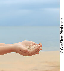 sand in hand of a child