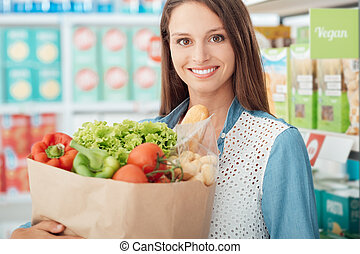 Woman buying healthy food
