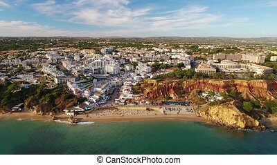 Aerial. Magic videography from sky, village Olhos de Agua Albufeira.