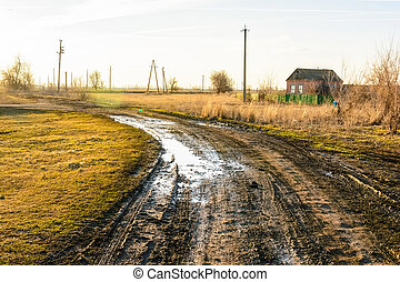 Wet muddy country road - Beautiful view of mud and puddles...