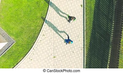 Two athletes running on stairs on sunny autumn day. - Two...