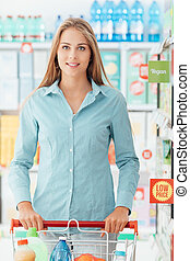 Shopping at the discount store - Happy woman shopping at the...