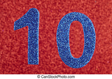 Number ten blue color over a red background. Anniversary.