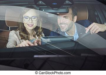 Couple testing brand new car