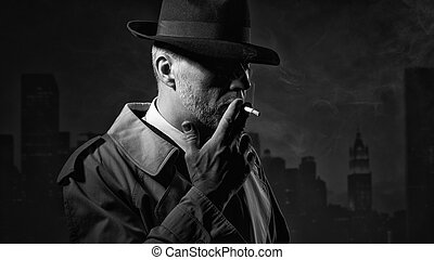 Man smoking a cigarette - Elegant old fashioned man in the...