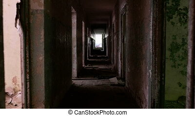 Corridor in the abandoned house. Smooth and slow steady cam...