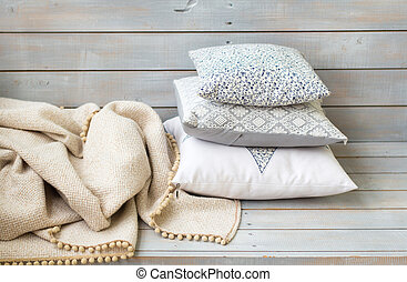 Cushions and plaid on the light wooden background - Cushions...