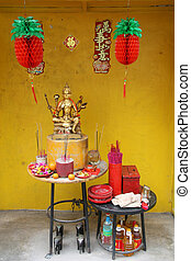 Asian culture - Small street shrine devoted to Hindu deva...