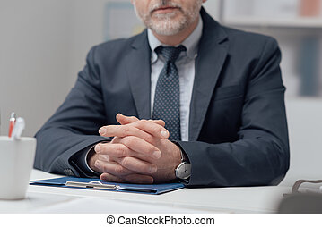 Confident businessman in his office - Confident businessman...