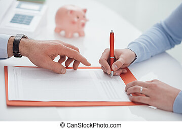 Financial planning - Woman signing a contract and financial...