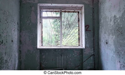 Window in the deserted house. Smooth and slow dolly shot.