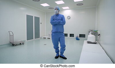 A man working in a clean room, pharmaceutical enterprise....