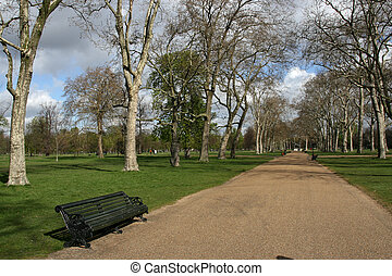 Hyde Park - Park bench and path in Hyde Park, London,...