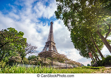 The Eiffel tower with car trails and cloudy sky - Wide angle...