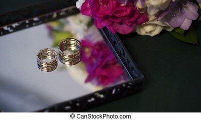 Pair of wedding rings on mirror