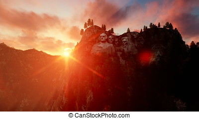 Mount Rushmore at sunset, camera fly