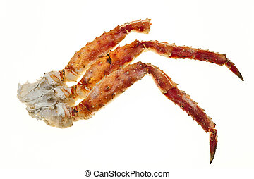 Crab meat in the shell. Crab legs closeup on a white...