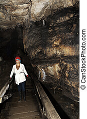Lepenica cave in Bulgaria - Woman walks out of Lepenica cave...