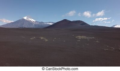 Old lava fields and volcanoes Tolbachik stock footage video...