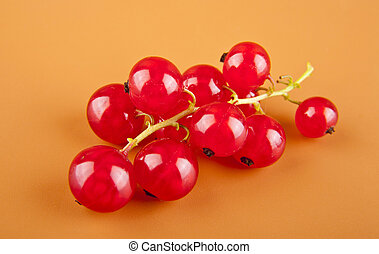 red currant on a brown background