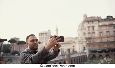 Tourist man takes selfie photos against the background of...