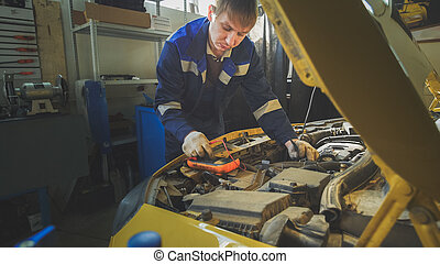 Small business - Mechanic in car repairing service -...