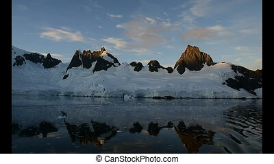 View of mountains in sunrise in Antarctica travel in Graham...