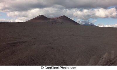 Old lava fields on slopes of volcanoes Tolbachik stock...