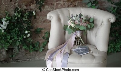 Wedding bridal bouquet on chair
