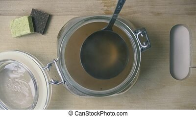 The bouillon is poured into the can for preservation. top...