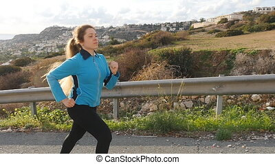 Young woman runner in slow motion. Sport concept