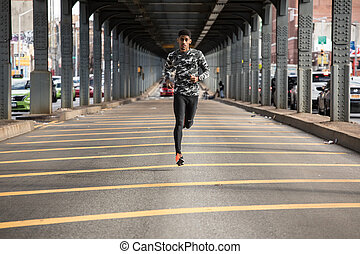 A young man goes for a jog in New York City - A young man...