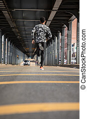 A young man goes running in the cold weather of Brooklyn,...