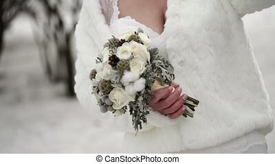 Bride with bouquet at winter day