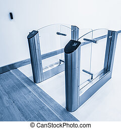 Stainless steel turnstiles. - Entrance to office with...