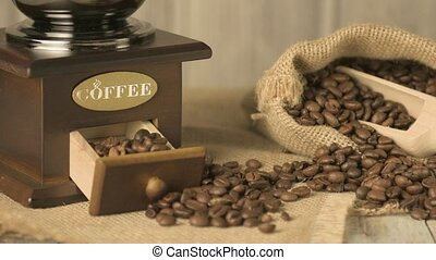 Coffee beans on old fashioned wooden table.