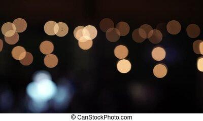 Lights blur abstract closeup pan