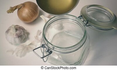 Chicken stock is poured into a glass jar. Slow mo