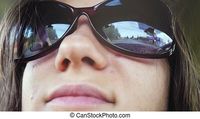 Close up of happy young smiles woman wears sunglasses...