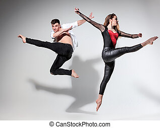 Two people dancing in contemporary stile of ballet at studio...