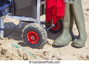 Cart for angling equipment on the beach - Fisher cart on sea...