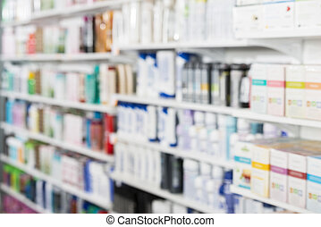 Products Arranged In Shelves At Pharmacy - Defocused image...
