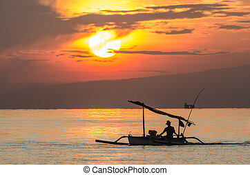 fishing boat at sunrise by the sea