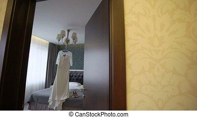 Wedding dress in bedroom - White wedding dress in bedroom