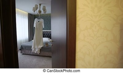 Wedding dress in bedroom - White wedding dress in bedroom
