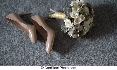 Bridal shoes and bouquet composition