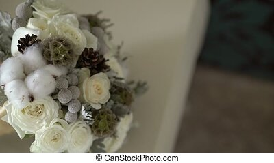 Wedding bridal bouquet on table in bedroom