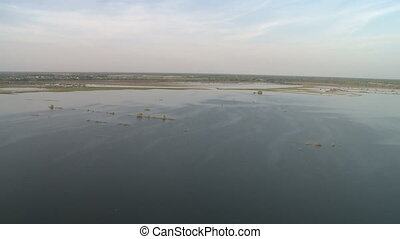 Spring river flood and sky landscape aerial view from board...