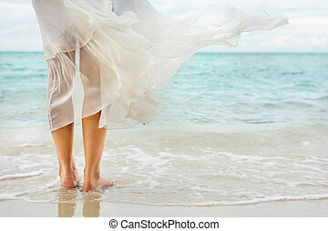 White dress waving on seaside wind