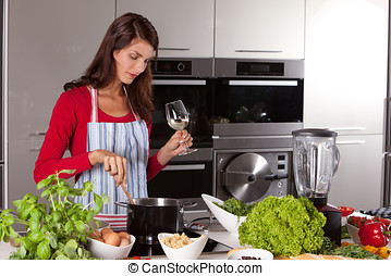 Pretty woman stirring in the pan - Attractive young female...